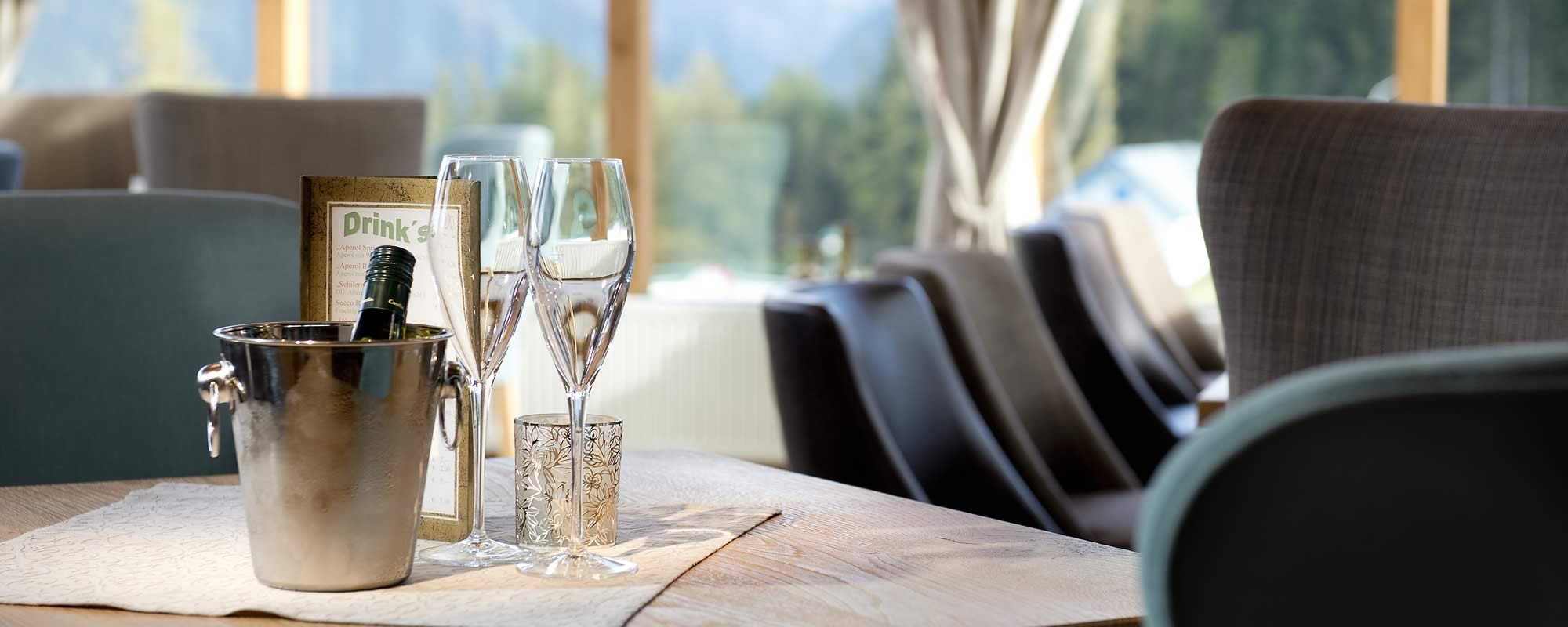 Have a glass of sparkling wine in the cozy bar area of the Hotel Waldfrieden
