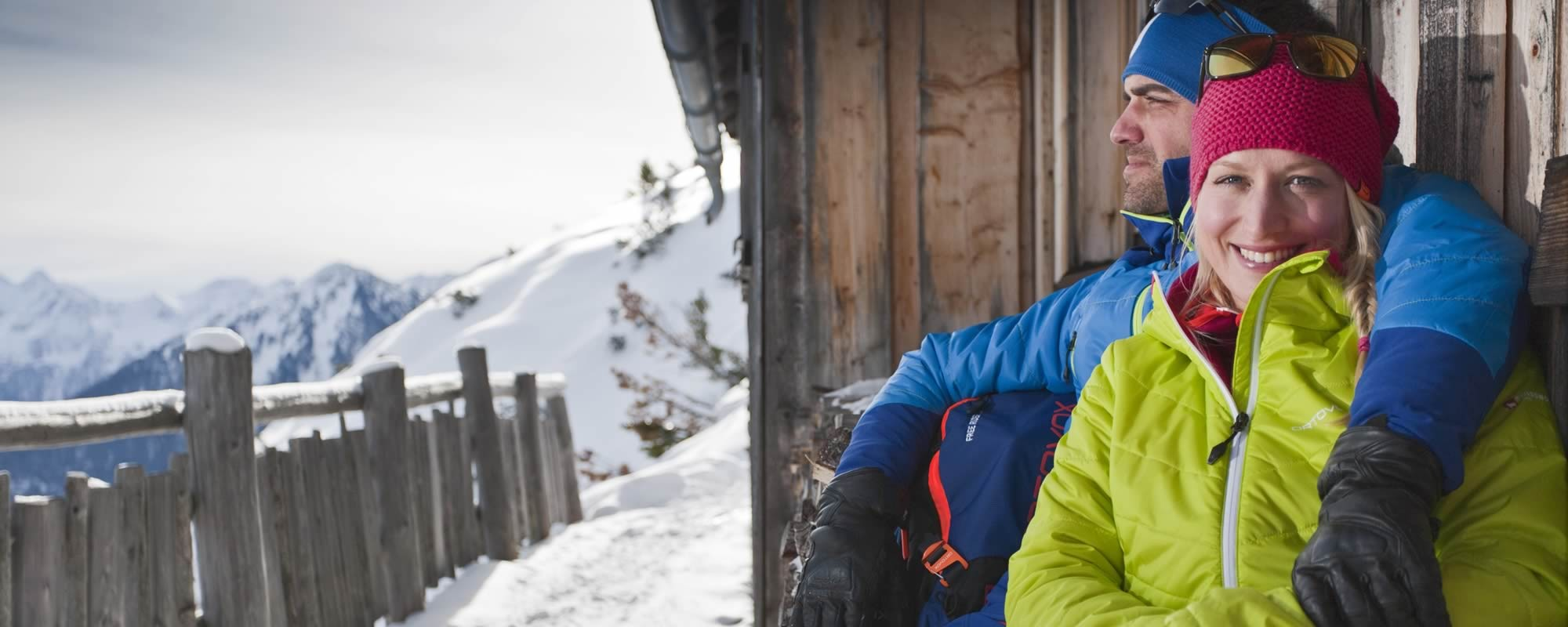 Couple at a mountain hut in winter in Schladming